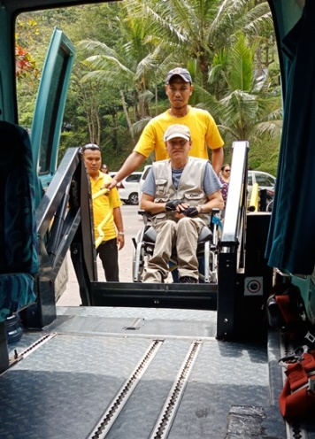Lift in minivan. Transport with wheelchair